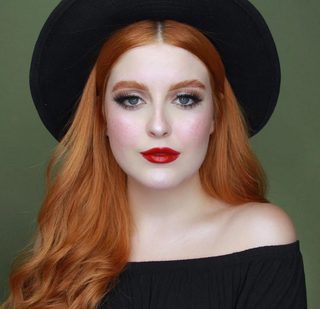 Red lipstick red haired woman